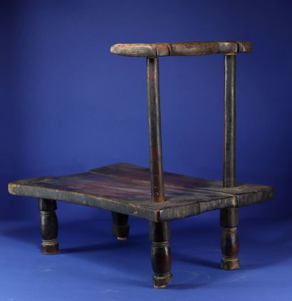 Low and narrow chair with beautiful patina of use. Wood and metal. Krou, Ivory Coast....
