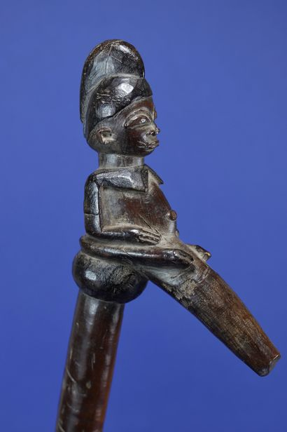 Chief's recade with a seated figure at the top. We recognize in this work the style...