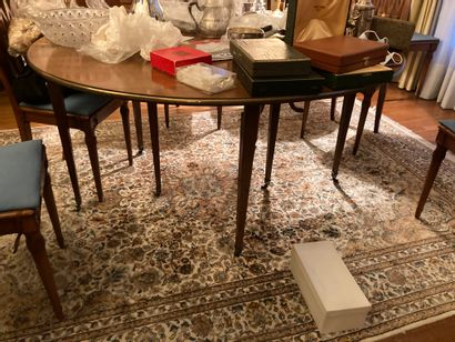 Mahogany and veneer half-moon table with retractable top. Two extensions. Early...