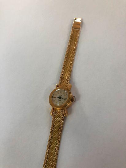 Bracelet montre de dame LUXE En or 750°°°, boitier rond, cadran blanc à index appliqués,...