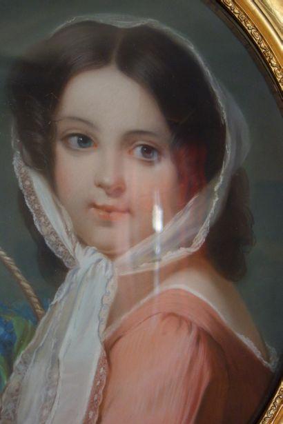 ECOLE FRANCAISE DU XIXème siècle Portrait of Eglantine with a basket of flowers Oval...