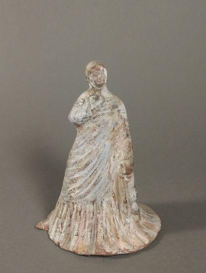 Figurine péplophore enveloppée dans un long...
