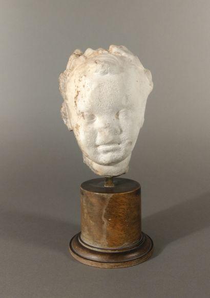 Child's head, perhaps of African origin....