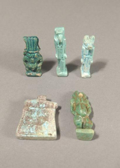 Lot of five amulets including a god Bes,...