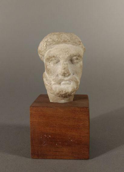Little bearded male head. Perhaps unfinished?...