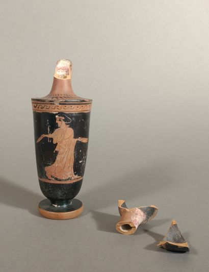 Red-figured lekythos depicting a woman passing...