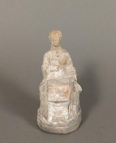 Seated Peplophorus figure holding an open...