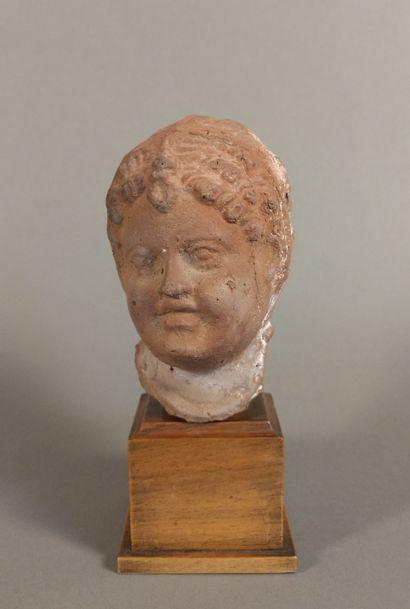 Ex-voto head representing a child whose headdress...