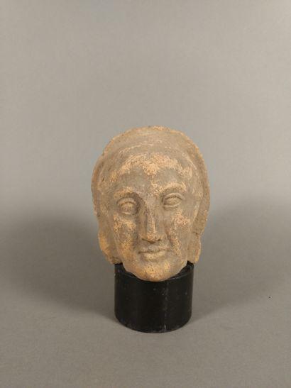 Male head ex-voto veiled  Ochre terracotta....
