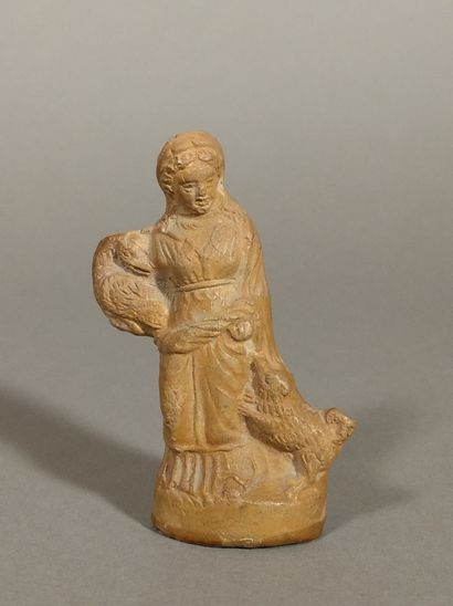 Statuette representing a standing woman,...