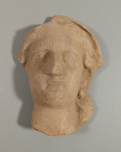 Ex-voto head representing a woman whose veil...