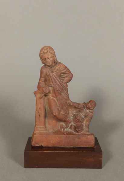 Figurine of a young man draped, leaning against...