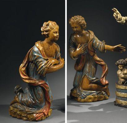 PAIRE D'ANGES BAROQUES En bois sculpté et polychrome Ces deux anges qui forment...