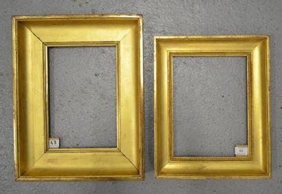 DEUX GORGES en bois mouluré et doré, à décor...