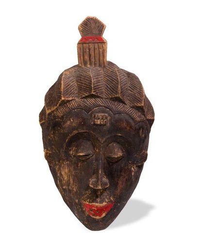 Masque dans le style Baoulé de Côte d'Ivoire...