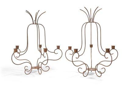 Paire de chandeliers en fer forgé à cinq...