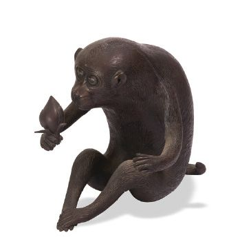 - Okimono en bronze de patine brune représentant...