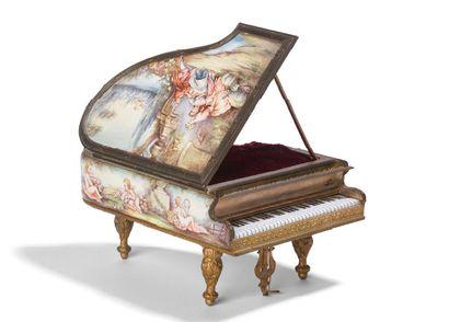 - Boite à musique en forme de piano à queue...