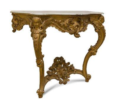 - Console en bois doré et sculpté, la ceinture...