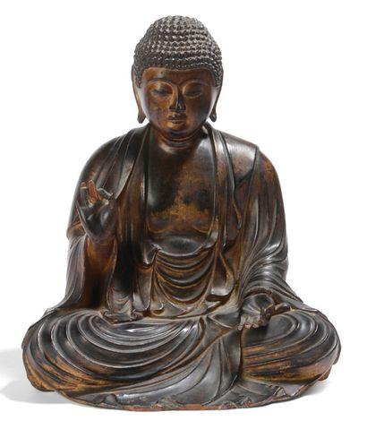 Sujet en bois, représentant le Bouddha assis...