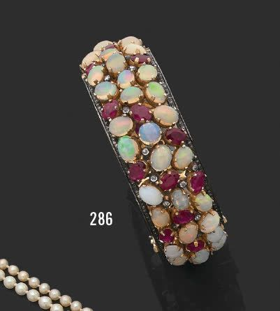 Bracelet rigide ouvrant en argent (925) pavé...