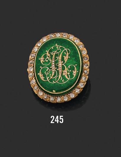 Oval brooch in 18k (750) yellow gold applied with green enamel monogrammed with...