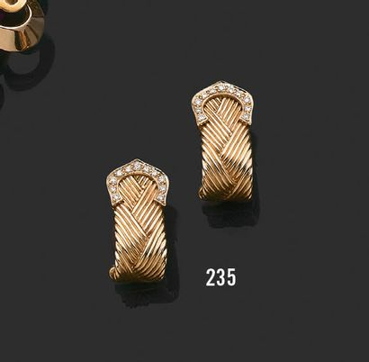 CARTIER C de Cartier A pair of earrings in 18k yellow gold and diamonds, with a braided...