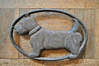 The basset hound, cast iron trivet. Length...