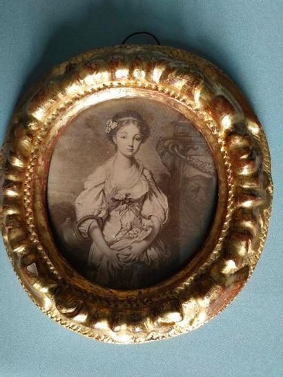 Engraving in a beautiful antique gilded wood...