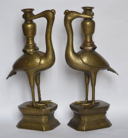 Pair of chiselled bronze waders supporting...