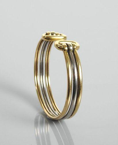 Bracelet ouvert formé de deux fils d'or jaune,...