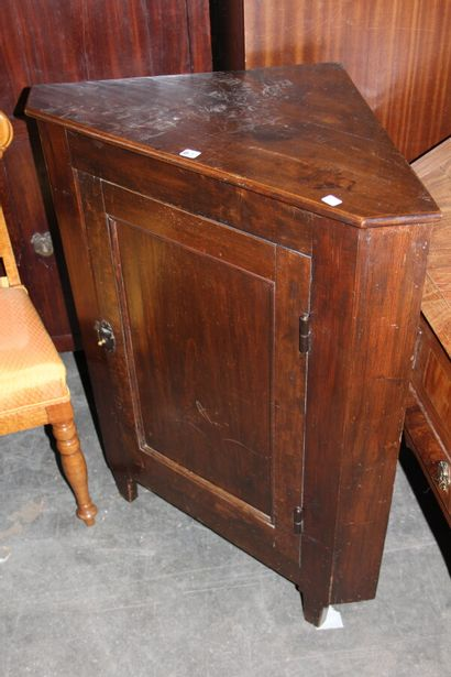 Rustic moulded and stained wood corner  Late 19th century.