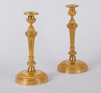 Paire de flambeaux en bronze doré du XIXème...