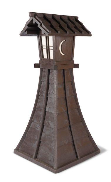 Lampadaire en bois teinté formant pagode...