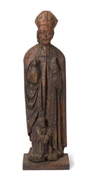 Figure d'évêque en bois sculpté ; (la base...
