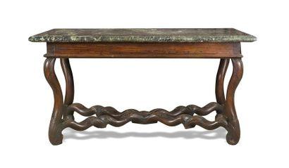 Table console en noyer sculpté de feuillages,...