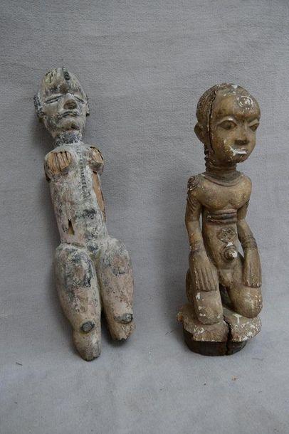 Deux statuettes en bois sculpté et polychromé...