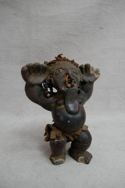 Statuette en bois sculpté (accidents et manques)...