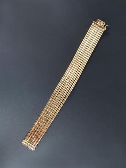 Bracelet souple en or jaune 18K (750°/°°)...