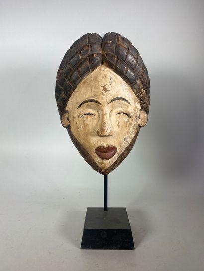 Ancien masque Punu à haute coiffe de sept...