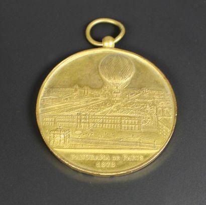 Médaille commémorative en bronze doré titrée...