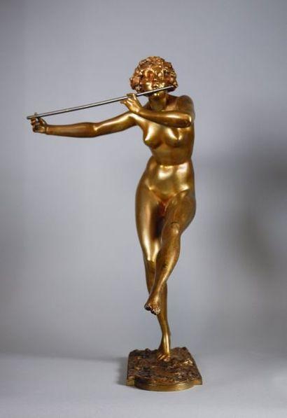 Paul PHILIPPE (1870-1930) Nu jouant de la flûte. Epreuve en bronze à patine dorée...