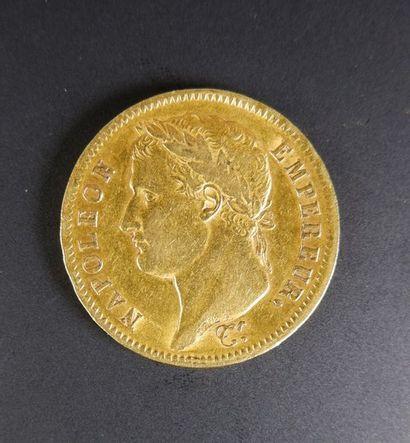 Pièce en or de quarante francs au profil...