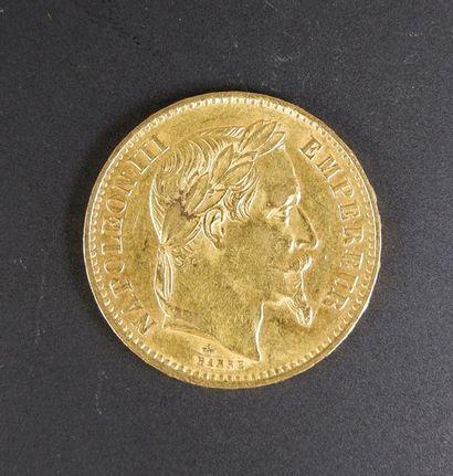 Pièce en or de vingt francs au profil de...