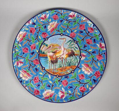 LONGWY Plat circulaire en céramique émaillée...