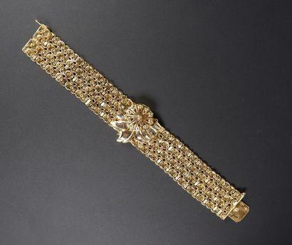 Large bracelet en ors jaune et gris 18K (750°/°°)...
