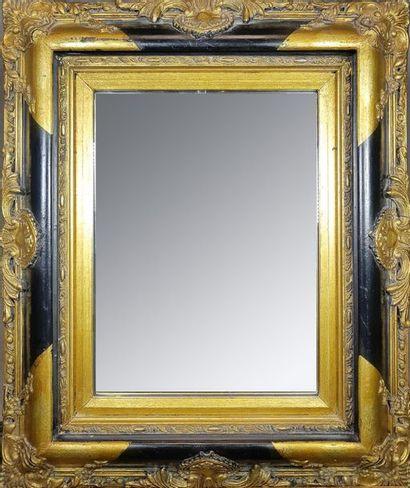 Petit miroir rectangulaire en bois noirci...