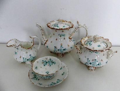Partie de service à thé en porcelaine à décor...