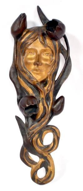 APPLIQUE lumineuse en bronze à patine brune...