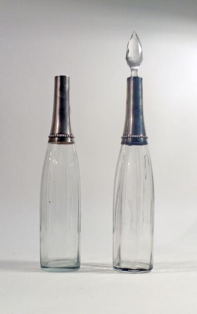 Deux FLACONS en cristal, le col en argent...